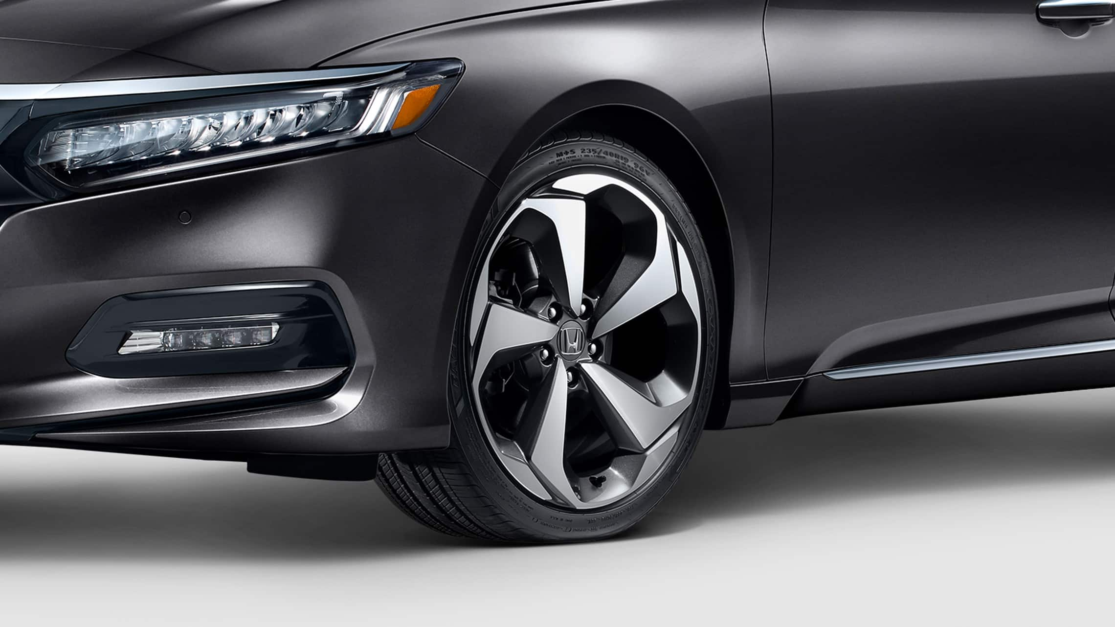 19-inch alloy wheel detail on the 2020 Honda Accord Touring 2.0T in Modern Steel Metallic.