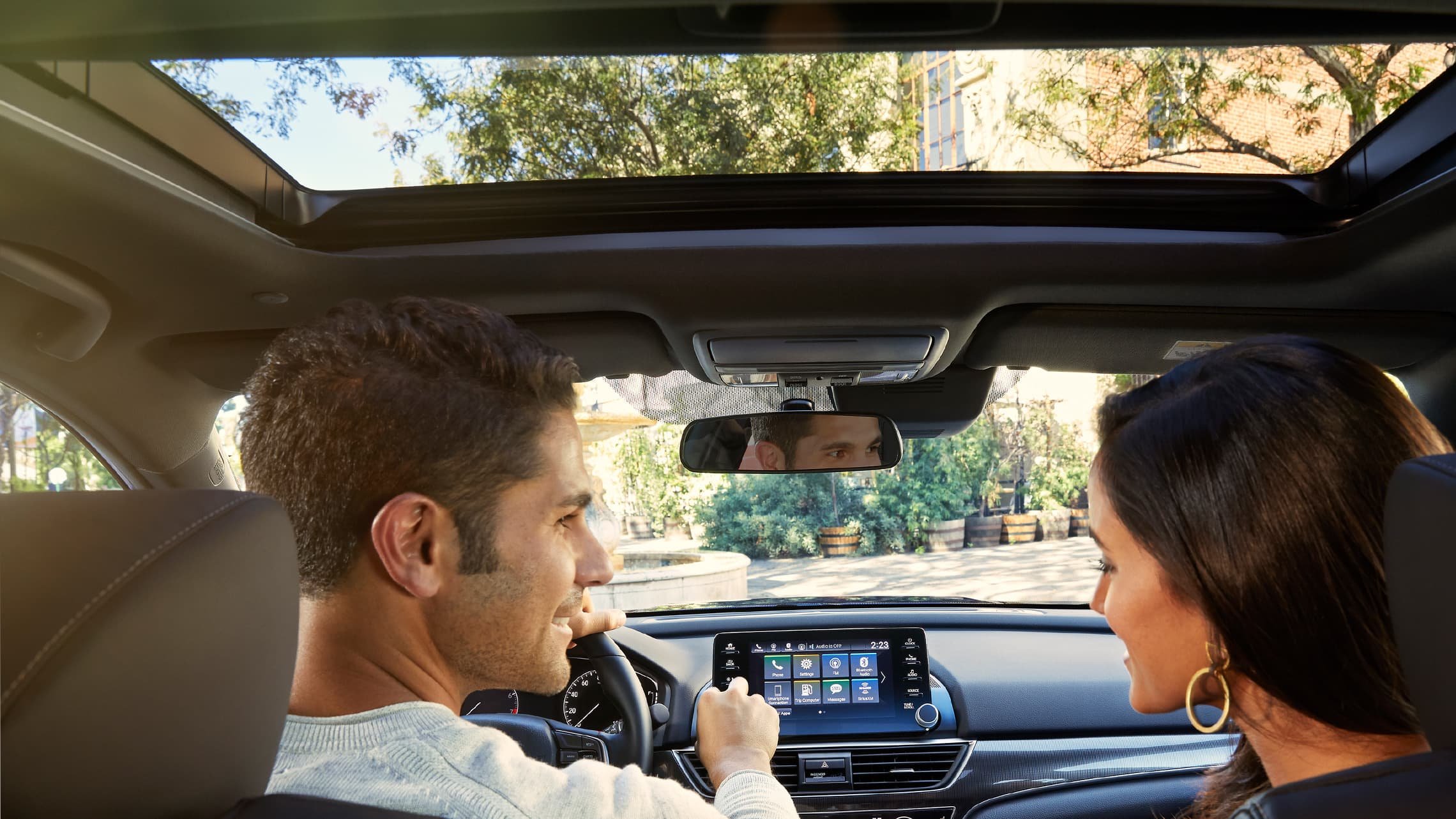 Interior backseat view of one-touch power moonroof detail shown opened in the 2020 Honda Accord Sport 2.0T.