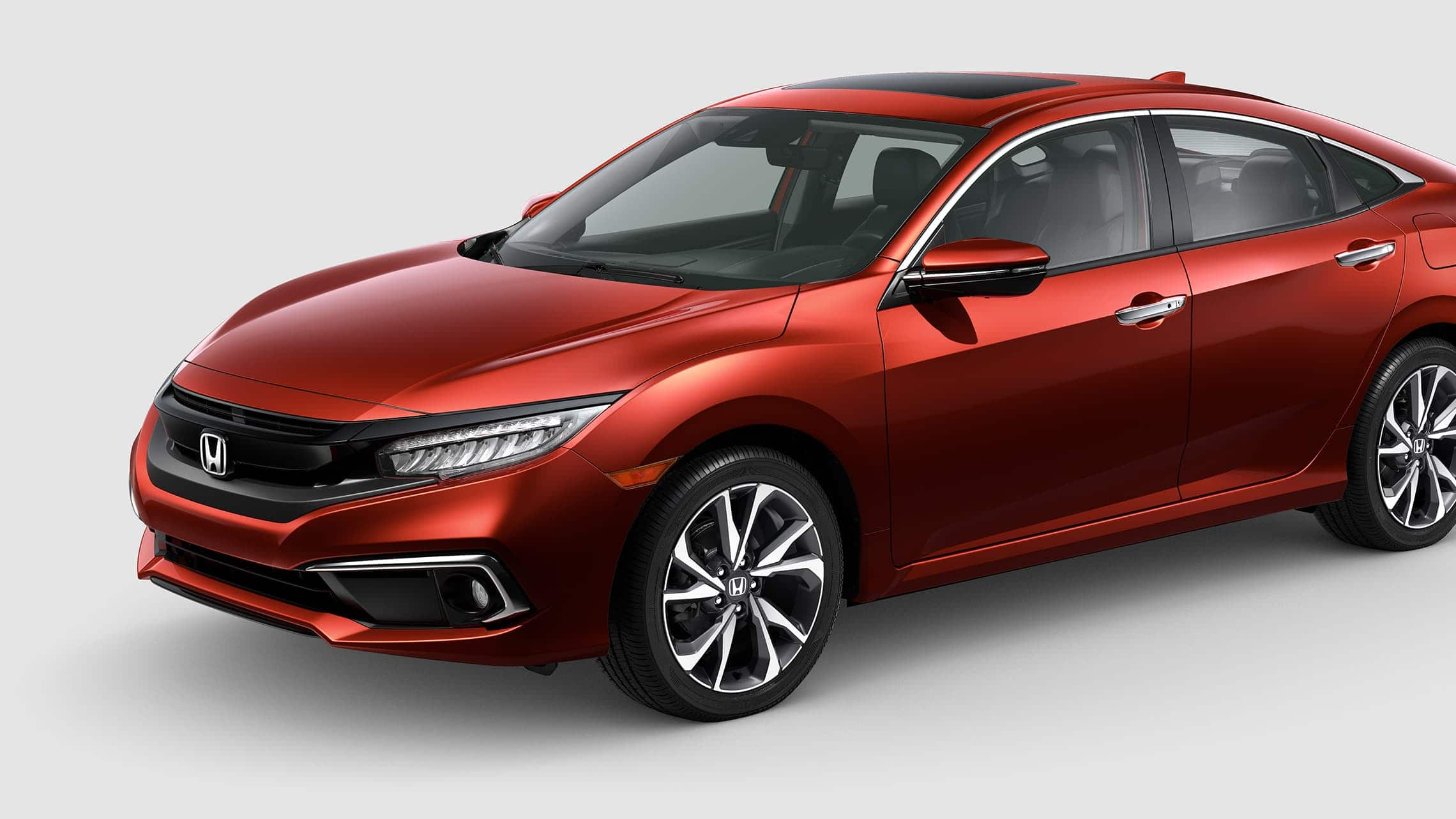 Front driver-side view of the 2020 Honda Civic Touring Sedan in Molten Lava Pearl.
