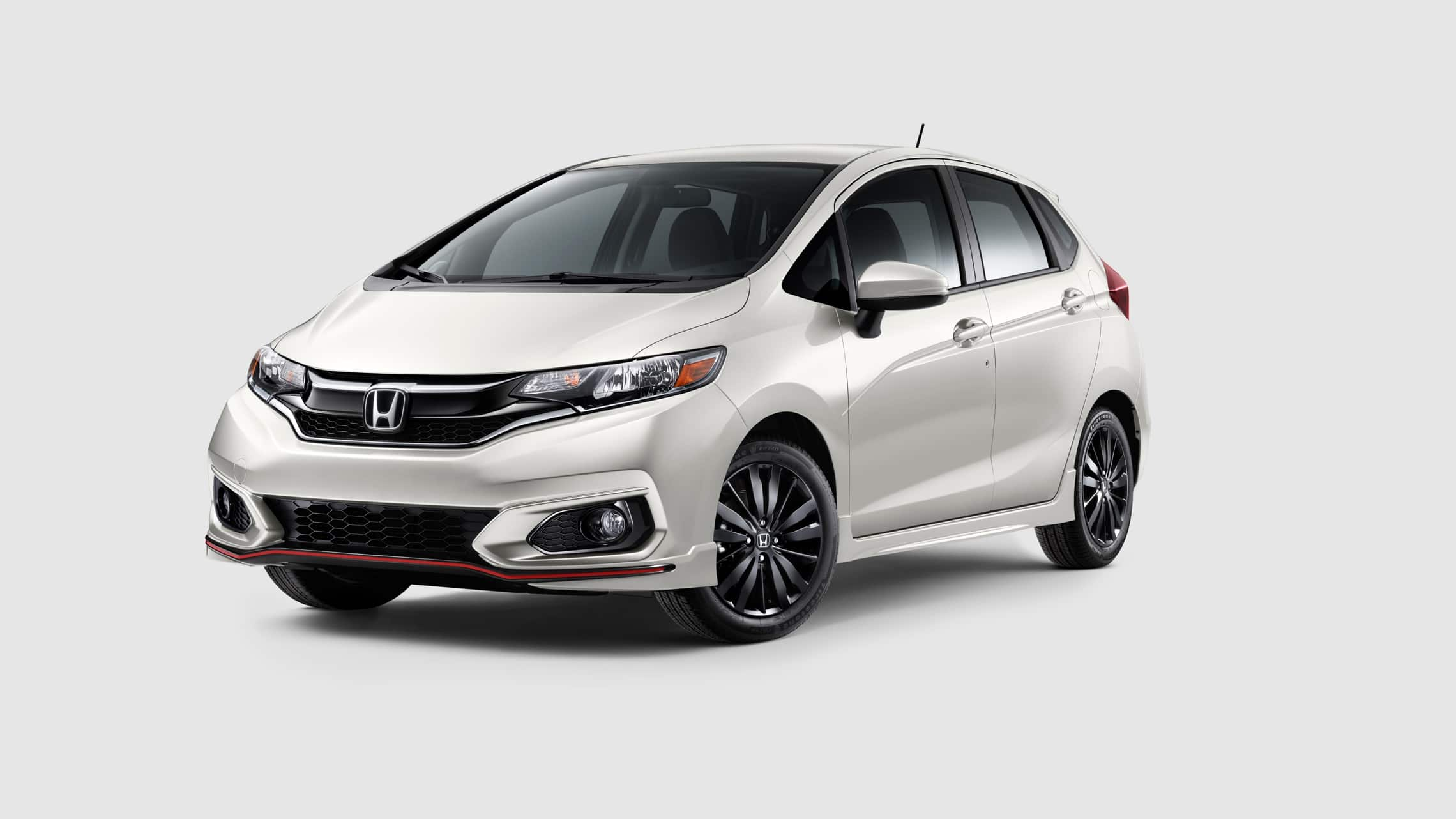 Front driver-side view of the 2020 Honda Fit Sport in Platinum White.