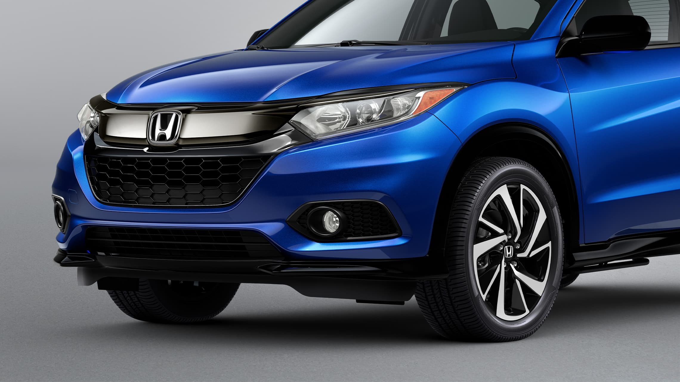 Front bumper garnish detail on the 2020 Honda HR-V Sport in Aegean Blue Metallic.