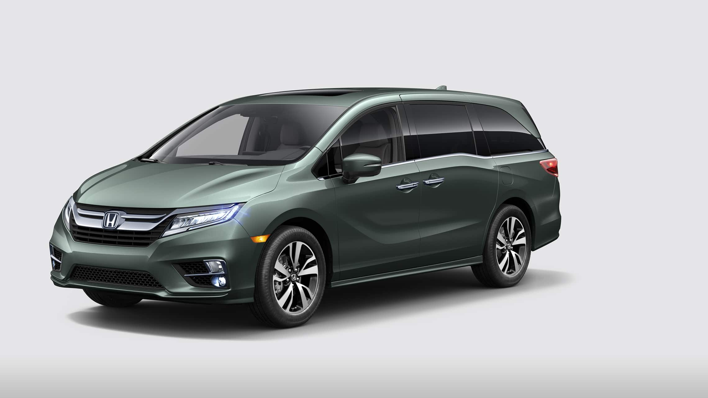 Front 3/4 driver-side view of 2020 Honda Odyssey Elite in Forest Mist Metallic.