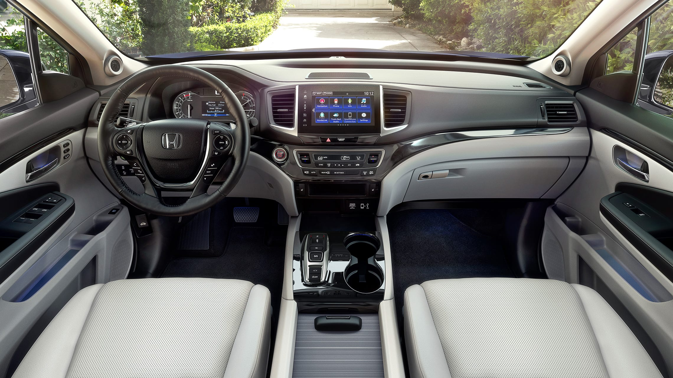 Interior cabin view of front seats in the 2020 Honda Ridgeline RTL-E with Gray Leather.