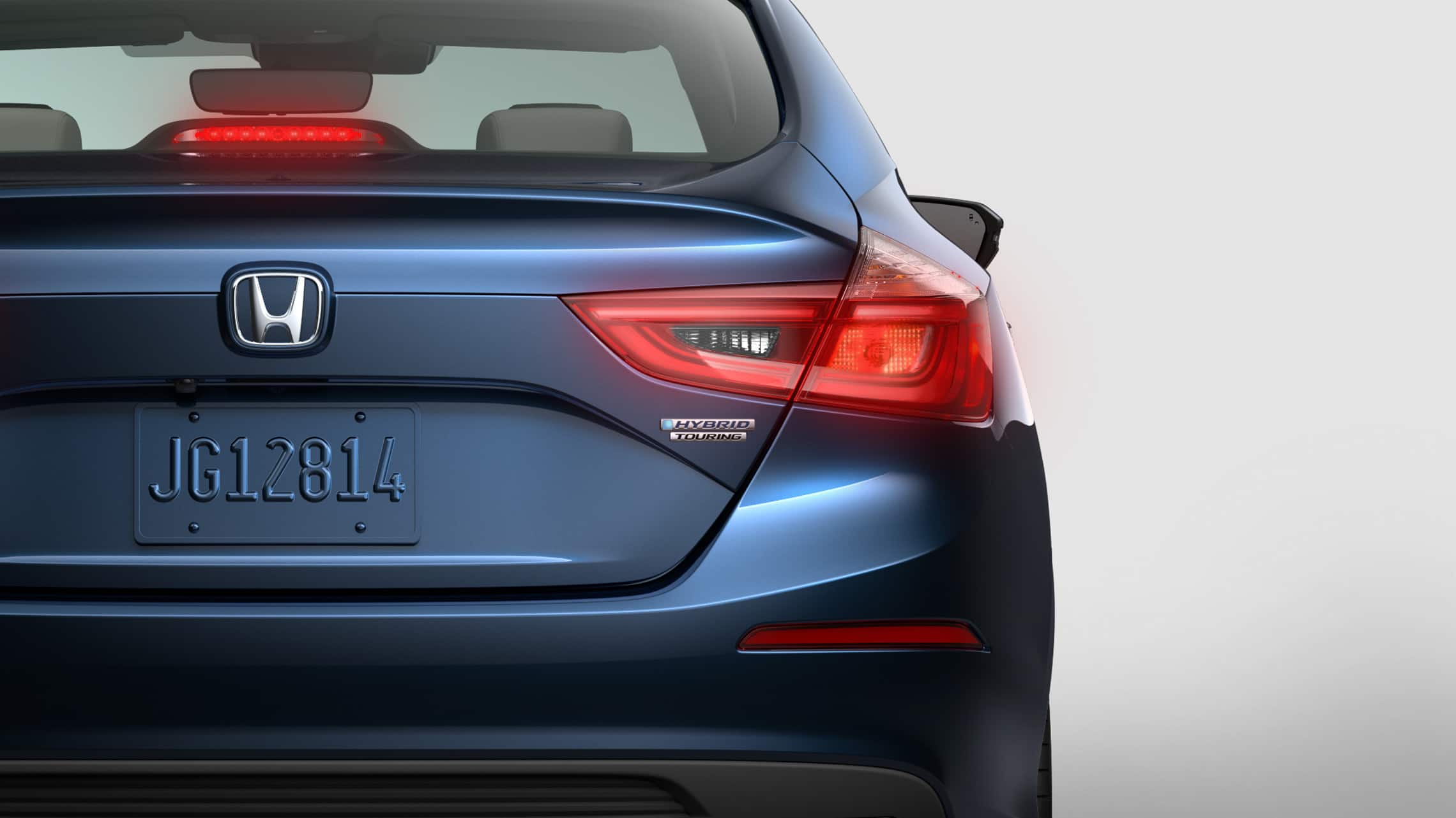 Rear close-up view of 2021 Honda Insight Touring in Cosmic Blue Metallic.