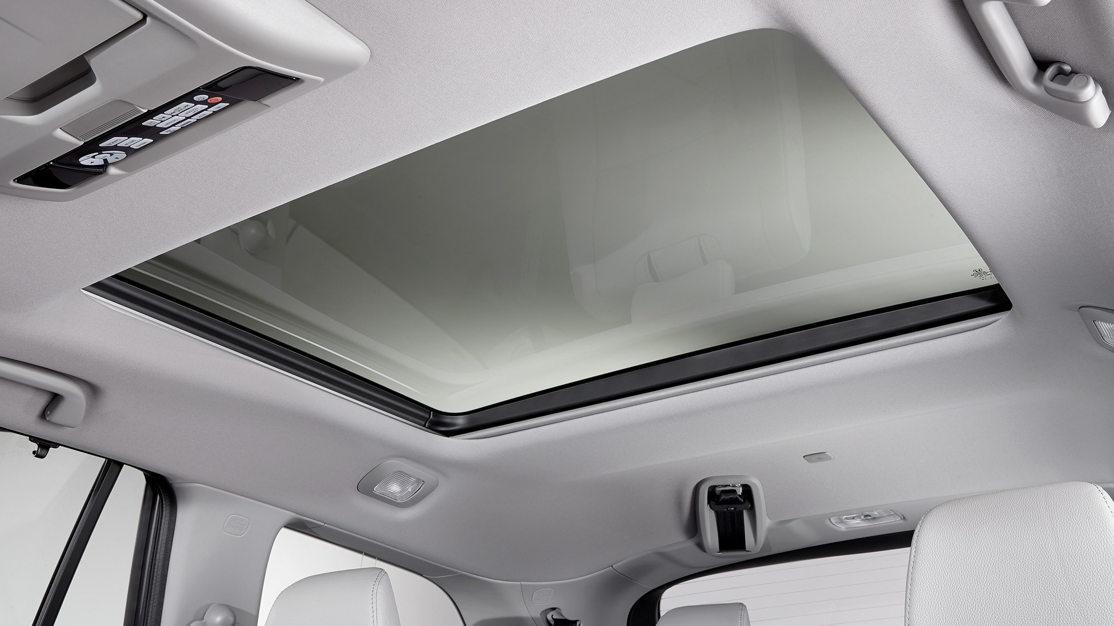 Panoramic roof detail on 2021 Honda Pilot Elite with Gray Leather.