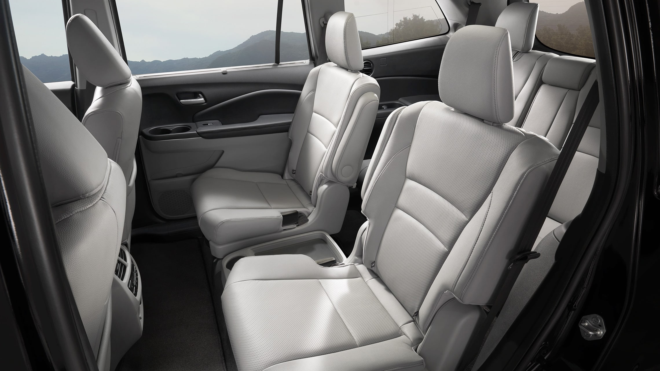 Detail of the 2nd-row captain's chairs in 2021 Honda Pilot Elite with Gray Leather.
